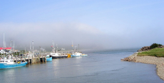 The fog is lifting at Alma's wharf in the early morning
